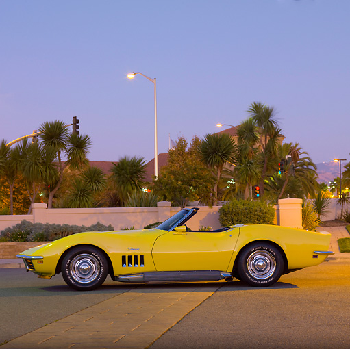 VET 03 RK0576 01 © Kimball Stock 1969 Chevrolet Corvette Convertible Yellow Profile View On Pavement By Palm Trees