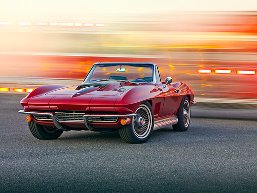 VET 03 RK0593 01 © Kimball Stock 1967 Chevrolet Corvette Sting Ray 427 Convertible Maroon 3/4 Front View On Pavement By Fire Trucks In Motion
