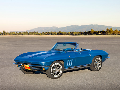 VET 03 RK0598 01 © Kimball Stock 1965 Chevrolet Corvette Convertible Nassau Blue 3/4 Front View On Pavement By Hills
