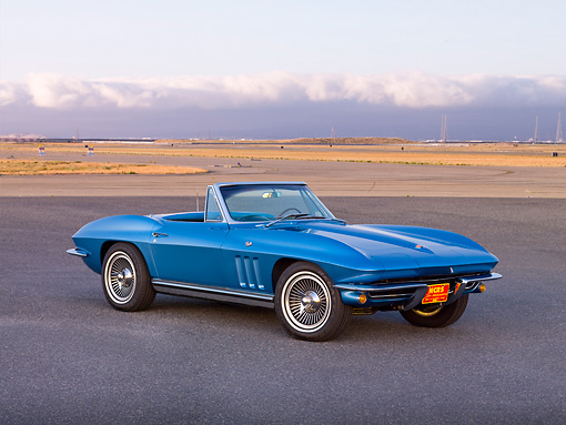 VET 03 RK0599 01 © Kimball Stock 1965 Chevrolet Corvette Convertible Nassau Blue 3/4 Front View On Pavement By Hills