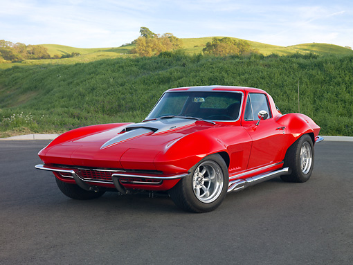 VET 03 RK0628 01 © Kimball Stock 1967 Chevrolet Corvette Red With Silver Stripe 3/4 Front View On Pavement By Hills