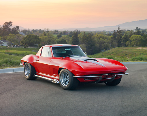 VET 03 RK0633 01 © Kimball Stock 1967 Chevrolet Corvette Sting Ray Red With Silver Stripe 3/4 Front View On Pavement By Hills