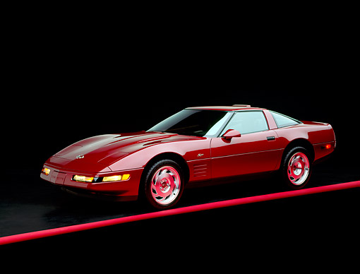 VET 04 RK0008 01 © Kimball Stock 1993 Chevrolet Corvette Anniversary Edition Burgundy 3/4 Side View On Red Line Studio