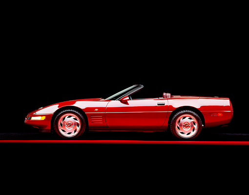 VET 04 RK0016 06 © Kimball Stock 1993 Chevrolet Corvette Anniversary Edition Burgundy Profile View On Red Line Studio