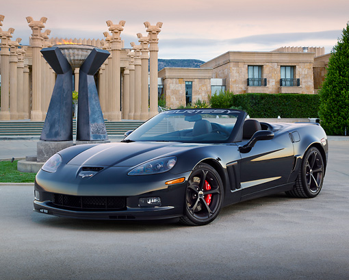 VET 04 RK0055 01 © Kimball Stock 2012 Chevrolet Corvette Convertible Centennial Edition Black 3/4 Front View On Pavement By Columns