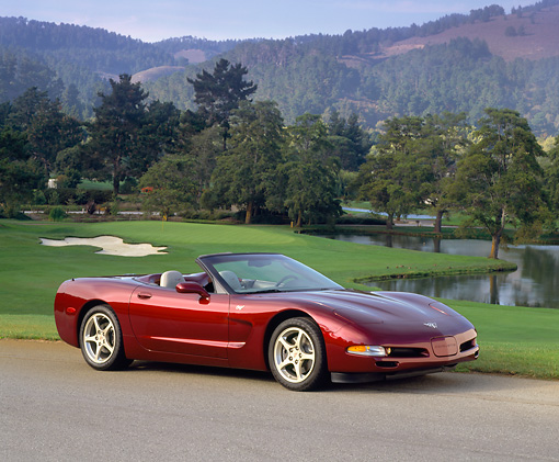 VET 04 RK0026 04 © Kimball Stock 2003 Chevrolet Corvette 50th Anniversary Edition Burgundy 3/4 Front View On Pavement By Golf Course And Lake