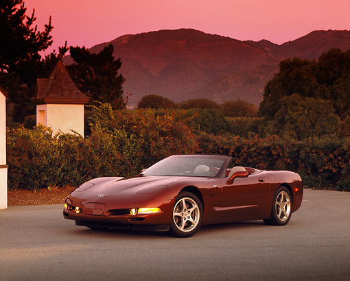 VET 04 RK0033 02 © Kimball Stock 2003 Chevrolet Corvette 50th Anniversary Edition Burgundy Front 3/4 View On Pavement