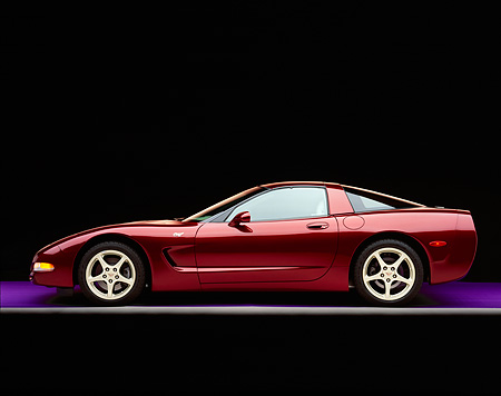 VET 04 RK0034 03 © Kimball Stock 2003 Chevrolet Corvette 50th Anniversary Edition Burgundy Profile On Purple Floor Gray Line Studio