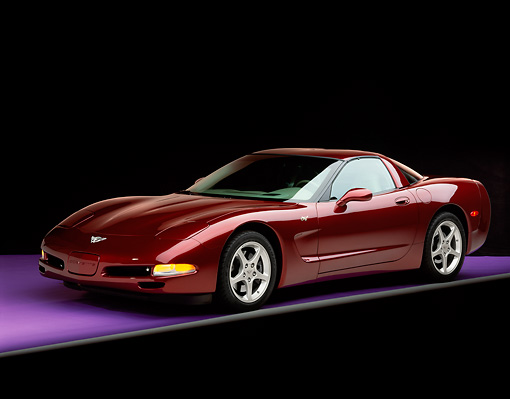VET 04 RK0037 07 © Kimball Stock 2003 Chevrolet Corvette 50th Anniversary Edition Burgundy Front 3/4 View On Purple Floor Gray Line Studio