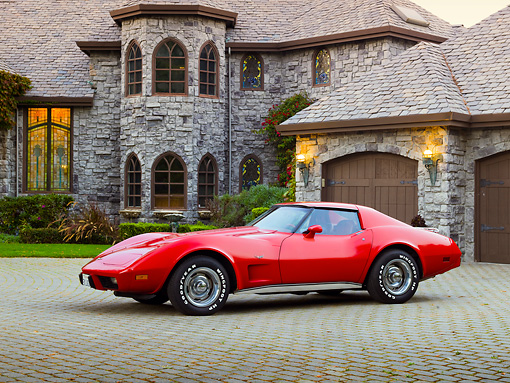 VET 05 RK0212 01 © Kimball Stock 1977 Chevrolet Corvette Red 3/4 Side View On Brick By House