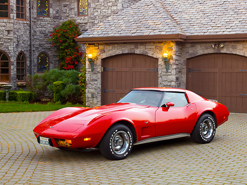 VET 05 RK0213 01 © Kimball Stock 1977 Chevrolet Corvette Red 3/4 Front View On Brick By House