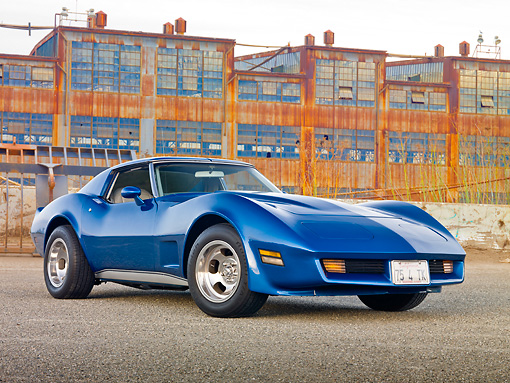 VET 05 RK0230 01 © Kimball Stock 1975 Chevrolet Corvette Blue 3/4 Front View On Pavement By Old Factory Buildings