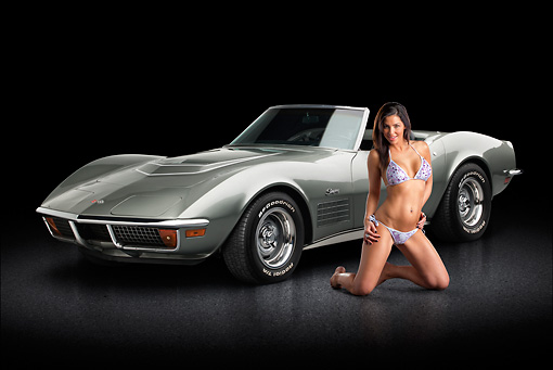 VET 05 RK0238 01 © Kimball Stock 1972 Chevrolet Corvette LT-1 Steel Cities Gray 3/4 Front View On Pavement With Swimsuit Model