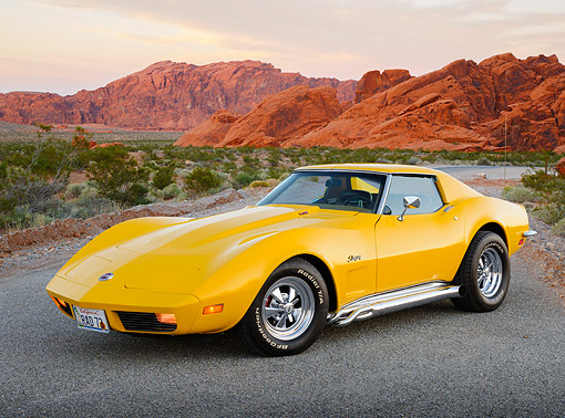 VET 05 RK0241 01 © Kimball Stock 1973 Chevrolet Corvette Stingray Yellow 3/4 Front View On Pavement In Desert