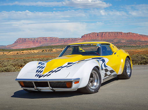 VET 05 RK0246 01 © Kimball Stock 1972 Chevrolet Corvette Yellow With Graphics 3/4 Front View On Pavement In Desert