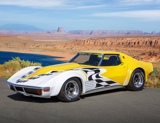 VET 05 RK0247 01 © Kimball Stock 1972 Chevrolet Corvette Yellow With Graphics 3/4 Side View On Pavement In Desert