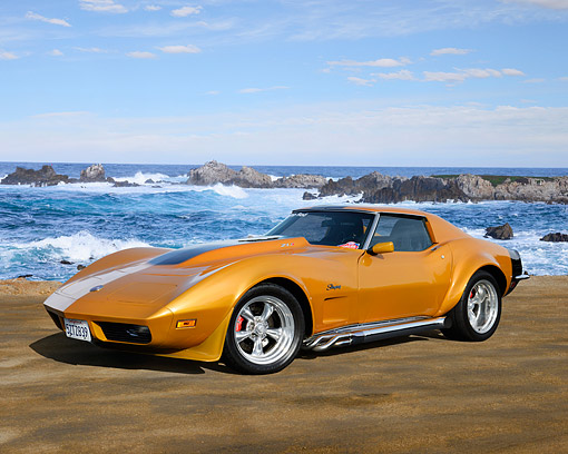 VET 05 RK0252 01 © Kimball Stock 1973 Chevrolet Corvette ZL1 Stingray Gold And Black 3/4 Front View On Sand By Ocean