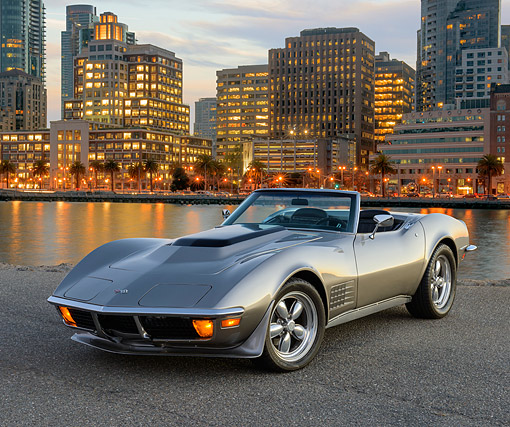 VET 05 RK0255 01 © Kimball Stock 1971 Chevrolet Corvette Gray 3/4 Front View On Pavement By Water And Buildings At Night