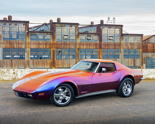 VET 05 RK0259 01 © Kimball Stock 1973 Chevrolet Corvette Stingray Harlequin 3/4 Side View On Pavement By Old Factory