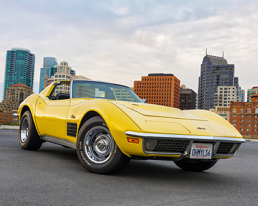VET 05 RK0262 01 © Kimball Stock 1970 Chevrolet Corvette 454 T-Top Daytona Yellow 3/4 Front View On Pavement By City