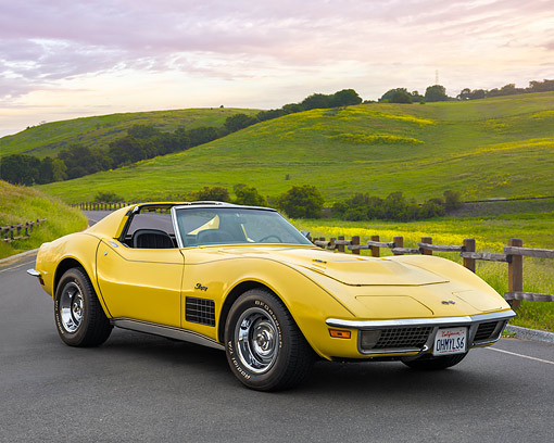 VET 05 RK0264 01 © Kimball Stock 1970 Chevrolet Corvette 454 T-Top Daytona Yellow 3/4 Front View On Pavement By Bucolic Hills