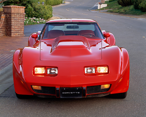 VET 05 RK0008 01 © Kimball Stock 1977 Chevrolet Corvette Sebring Greenwood Red Head On View On Pavement