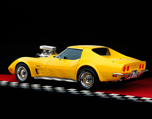 VET 05 RK0112 05 © Kimball Stock 1973 Chevrolet Corvette Modified Yellow 3/4 Rear View On Red Floor Studio