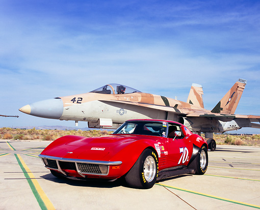 VET 05 RK0118 01 © Kimball Stock 1970 Chevrolet Corvette Red Race Car 3/4 Front View On Pavement By Fighter Jet