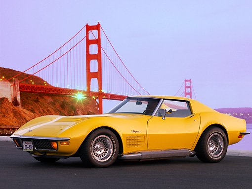 VET 05 RK0145 01 © Kimball Stock 1972 Chevrolet Corvette Coupe Yellow 3/4 Front View On Pavement By Golden Gate Bridge