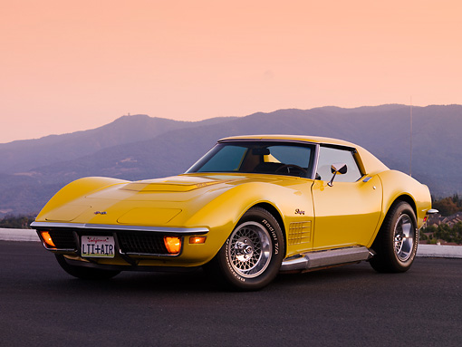 VET 05 RK0148 01 © Kimball Stock 1972 Chevrolet Corvette Coupe Yellow 3/4 Front View On Pavement By Mountain
