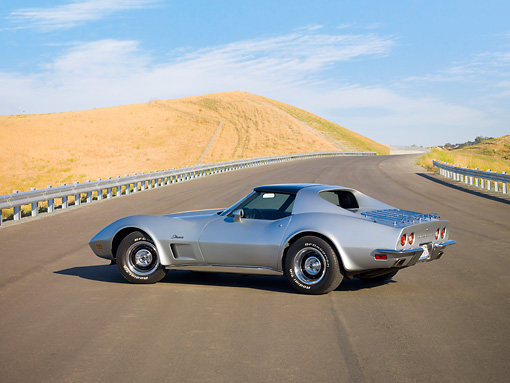 VET 05 RK0164 01 © Kimball Stock 1973 Chevrolet Corvette Coupe Silver 3/4 Rear View By Hill