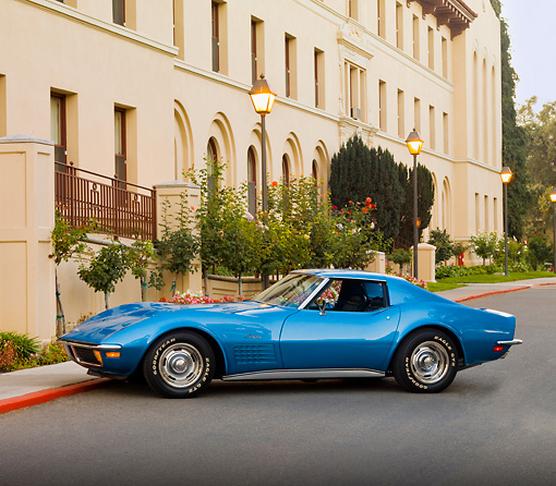VET 05 RK0186 01 © Kimball Stock 1971 Chevrolet Corvette Stingray Blue 3/4 Front View On Pavement By Building
