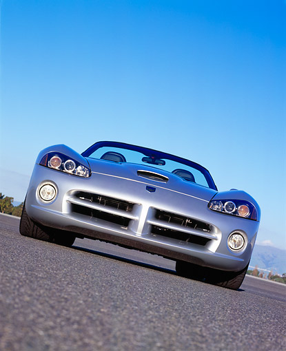 VIP 01 RK0163 06 © Kimball Stock 2003 Dodge Viper Convertible Silver Low Head On Shot On Pavement Blue Sky