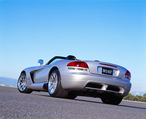 VIP 01 RK0165 01 © Kimball Stock 2003 Dodge Viper Convertible Silver Low 3/4 Rear View On Pavement Blue Sky