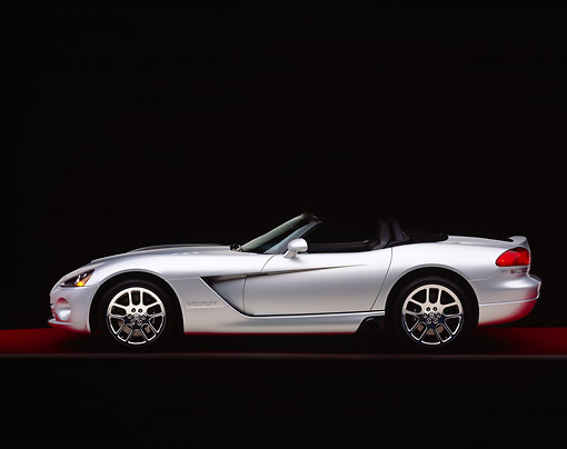 VIP 01 RK0176 02 © Kimball Stock 2003 Dodge Viper Convertible Silver Side View On Gray Line Red Floor Studio