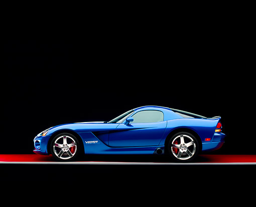 VIP 01 RK0241 03 © Kimball Stock 2006 Dodge, Viper SRT 10, Blue White Stripe Profile View On Red Floor Studio