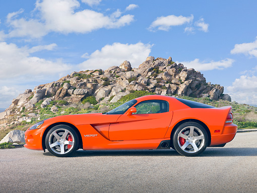 VIP 01 RK0314 01 © Kimball Stock 2010 Dodge Viper SRT/10 Coupe Orange With Black Stripe Profile View On Gravel By Rocky Hill