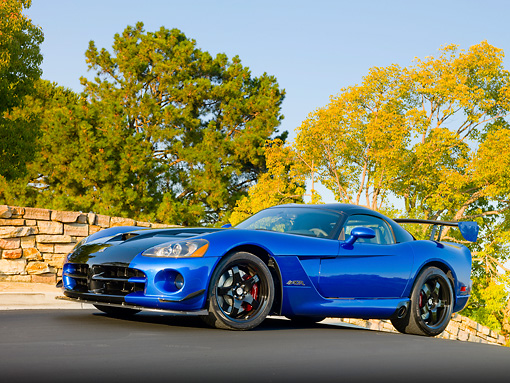 VIP 01 RK0324 01 © Kimball Stock 2010 Dodge Viper ACR Blue With Black Stripe 3/4 Front View On Pavement By Stone Wall And Trees