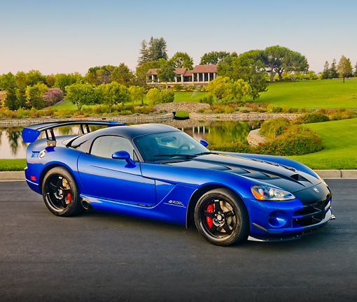 VIP 01 RK0328 01 © Kimball Stock 2010 Dodge Viper ACR Blue With Black Stripe 3/4 Front View On Pavement By Pond And Trees