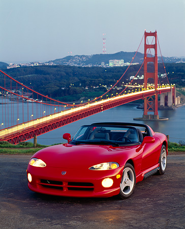 VIP 01 RK0008 07 © Kimball Stock 1993 Dodge Viper Red 3/4 Front View By Golden Gate Bridge At Night