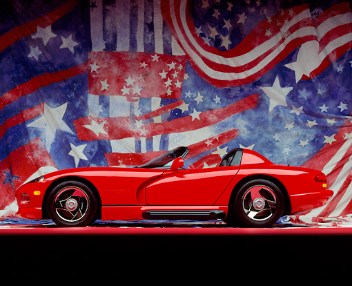 VIP 01 RK0016 08 © Kimball Stock Dodge Viper Red Convertible Profile View On Red Line American Design Background