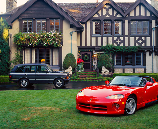 VIP 01 RK0076 36 © Kimball Stock 1994 Red Dodge Viper On Grass In Front Of House With Range Rover In Driveway