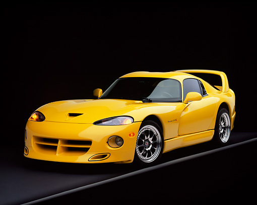 VIP 01 RK0126 04 © Kimball Stock 1996 Hennessey Viper Venom 650R Yellow 3/4 Front View On Gray Line Headlights On Studio