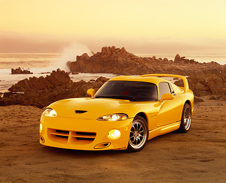 VIP 01 RK0149 02 © Kimball Stock 1996 Dodge Hennessey Viper Venom 650R Yellow 3/4 Front View On Sand By Ocean Filtered