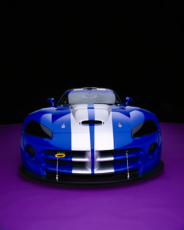VIP 01 RK0196 07 © Kimball Stock 2003 Dodge Viper Competition Coupe Blue Silver Stripe Wide Angle Head On Purple Floor
