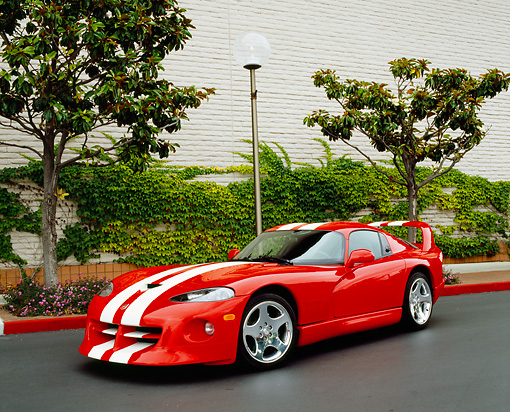 VIP 01 RK0215 01 © Kimball Stock 2002 Dodge Viper Red With White Stripes 3/4 Front View On Pavement By Bushes And Trees
