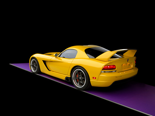 VIP 01 RK0245 01 © Kimball Stock 2006 Hennessey Venom 800R Yellow 3/4 Rear View Studio