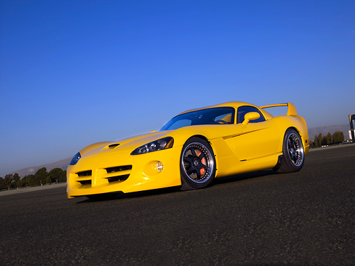 VIP 01 RK0255 01 © Kimball Stock 2006 Hennessey Venom 800R Yellow Low 3/4 Side View On Pavement