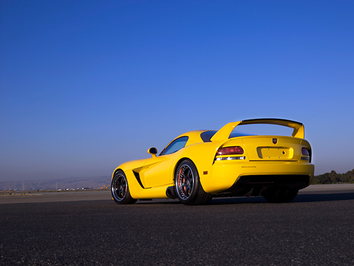 VIP 01 RK0256 01 © Kimball Stock 2006 Hennessey Venom 800R Yellow Low 3/4 Rear View On Pavement