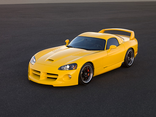 VIP 01 RK0259 01 © Kimball Stock 2006 Hennessey Venom 800R Yellow Overhead 3/4 Side View On Pavement